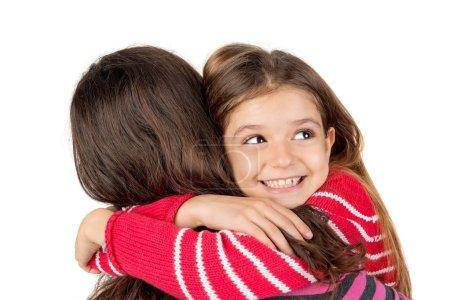 Photo pour Mère et fille étreindre isolé en blanc - image libre de droit