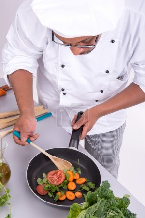 Photo for Male chef with fruits and vegetables cooking - Royalty Free Image