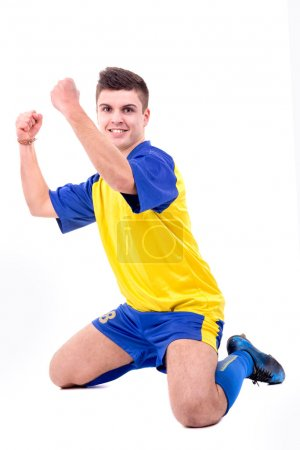 Photo for Football player celebrating a goal isolated in white - Royalty Free Image
