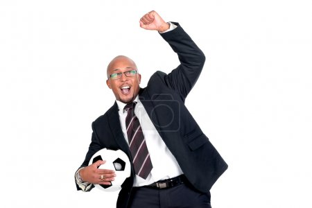 Photo for Businessman with soccer ball celebrating a goal, isolated in white - Royalty Free Image