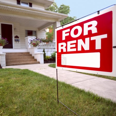 Photo for Home For Rent Sign in Front of Beautiful American Home - Royalty Free Image
