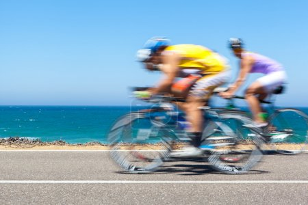 Cyclists competition along a coastal road