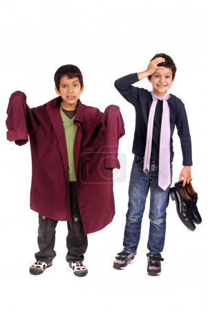 Boys dressing father's suit