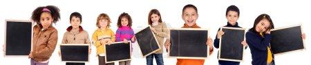 little kids holding a black board