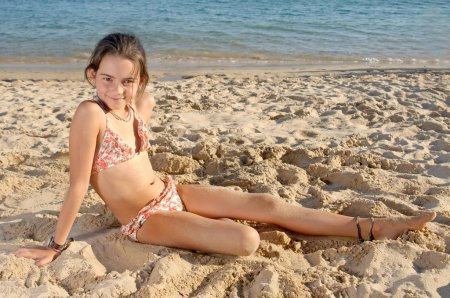 Photo for Little girl on the beach - Royalty Free Image