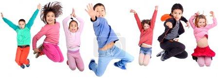 Foto de Grupo de niños saltando aislada en blanco - Imagen libre de derechos