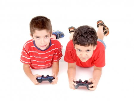 Photo for Little boys playing video games isolated in white - Royalty Free Image