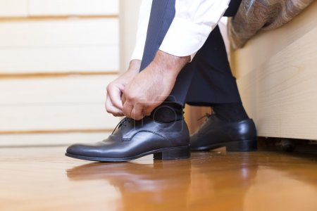 Photo for Groom putting his  wedding shoes - Royalty Free Image
