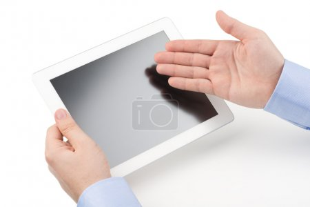 Man holding a tablet computer and directing with other hand towa