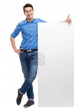 Casual young guy with blank board