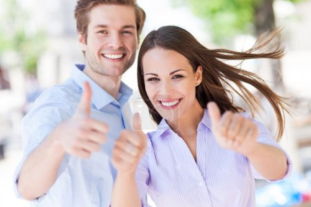 Photo for Young couple showing thumbs up - Royalty Free Image