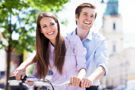 Young couple on bike