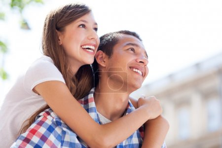 Photo for Teenage couple with mp3 player - Royalty Free Image