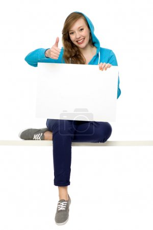 Photo for Woman holding blank poster - Royalty Free Image