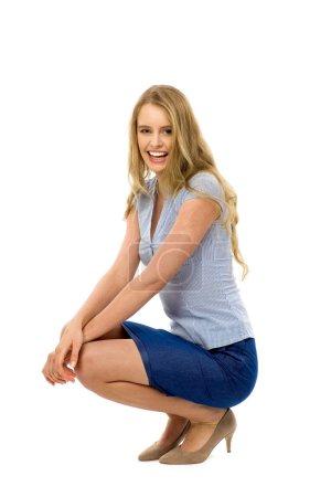 Young woman crouching
