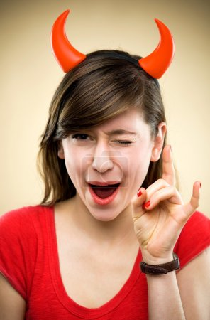 Photo for Woman wearing devil horns - Royalty Free Image