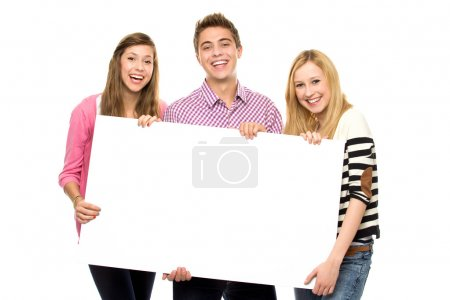 Three young holding blank poster