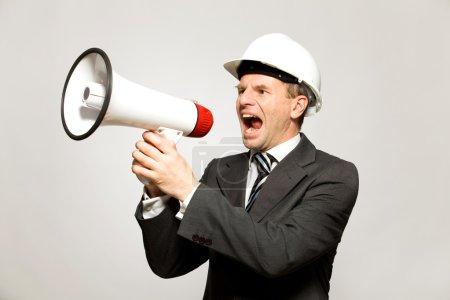 Workman Shouting Through Megaphone