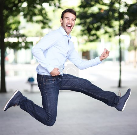 Photo for Man jumping with joy on the street - Royalty Free Image