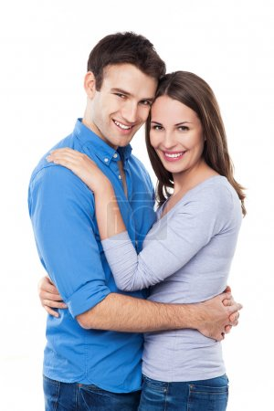 Photo for Young couple hugging over white background - Royalty Free Image