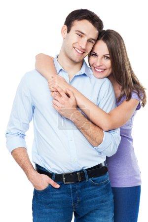 Foto de Feliz joven pareja aislada en blanco - Imagen libre de derechos