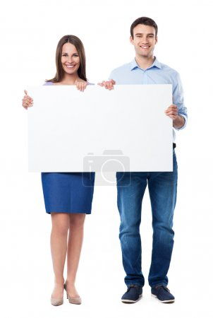 Young couple holding a placard