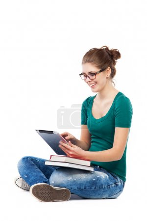 Teenage girl sitting with digital tablet