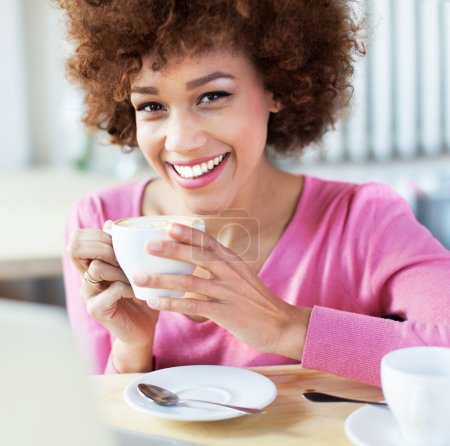 Photo for Woman enjoying a cup of tea - Royalty Free Image