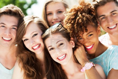 Photo for Group of happy young friends outdoors - Royalty Free Image