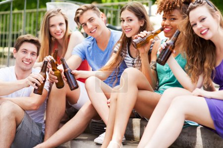Photo for Group of friends drinking beer outdoors - Royalty Free Image