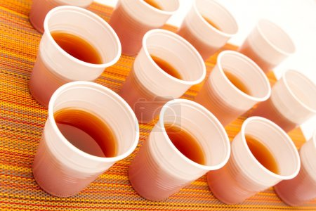 Disposable cups with tea