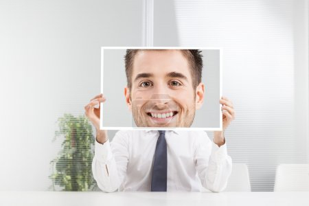 Photo for Businessman holding picture with big smile - Royalty Free Image