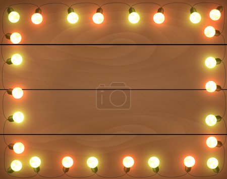 Christmas lights on wooden background, frame with garlands, hori