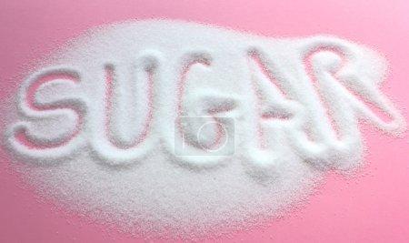 Sugar written in granulated sugar pile