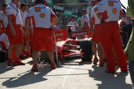 Photo for Scuderia Ferrari crew practicing at pit stop - Royalty Free Image