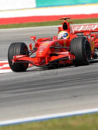 Photo for Felipe Massa negotiating a turn at Sepang F1 Malaysia 2007 Grand Prix - Royalty Free Image