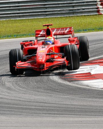 Photo for Felipe Massa lifts the tyre while negotiating a turn at Sepang F1 Malaysia 2007 Grand Prix - Royalty Free Image