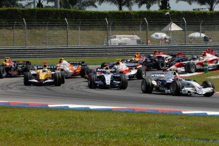 Photo for Formula One cars racing at F1 PETRONAS Grand Prix Sepang Malaysia 2007 - Royalty Free Image