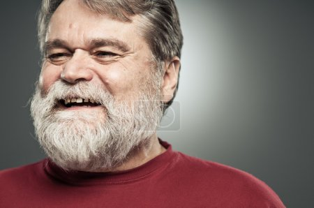 Mature Caucasian Man Laughing And Looking Away