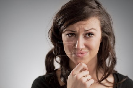 Beautiful Young Caucasian Woman Making A Decision