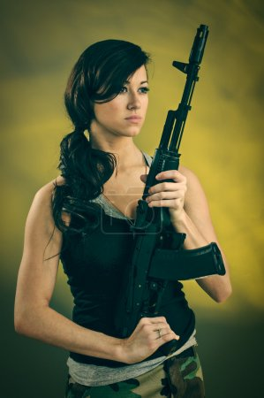 Militarized Young Woman WIth Assault Rifle