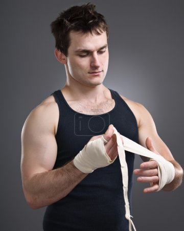 Fighter Taping His Hands Before A Fight