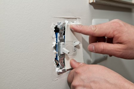 Installing Insulation On A Light Fixture