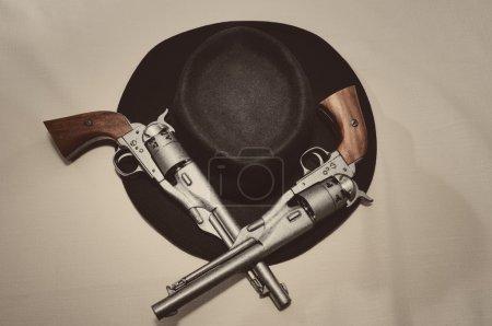 Hat and guns