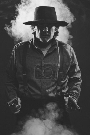 Wild west Gunslinger holding pistols in both hands...