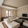 Travertine house: Horizontal view of a living room...