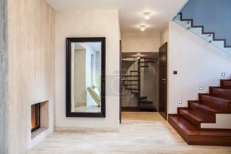 Travertine house: mirror and stairs