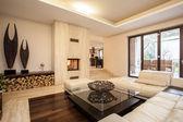 Travertine house: Beige living room