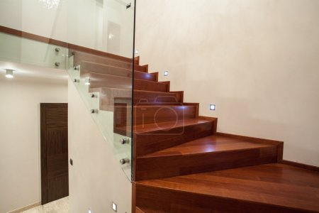 Photo for Travertine house - modern glass, metal and wooden staircase - Royalty Free Image