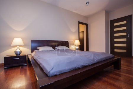 Travertine house - wooden bed